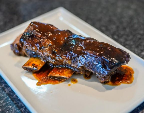 bbq ribs food in a white plate